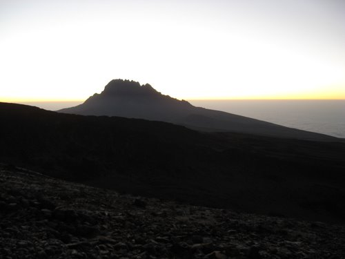 Sunrise from Barafu. Mawenzi peak in the distance.