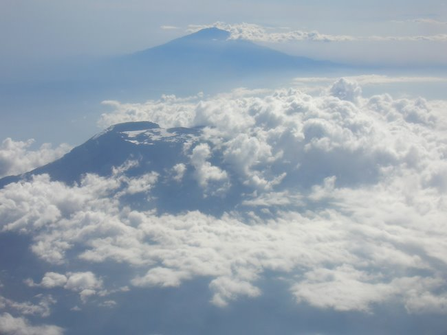 Mt. Kilimanjaro (Uhuru) foreground; Mt. Meru Background